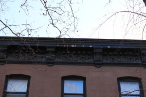 Maintenance of paint on character-defining features of buildings, such as this property's cornice, will protect the irreplaceable historic materials that make the building distinctive.